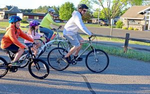 Celebrate National Bike Month by adopting these healthy habits